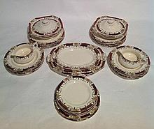 An Alfred Meakin dinner service: 12 dinner plates,