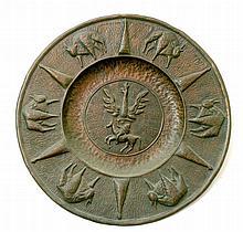 An old circular copper plaque.