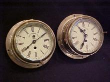 Lot of 2 Brass Royal Navy ship clocks.