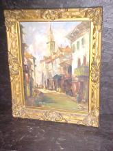 Early village/town street scene in gold gilt frame.  Signed Charles Scott