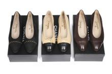 Three pairs of Chanel pumps, modern, stamped to the interiors, comprising b