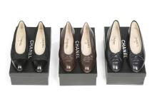 Three pairs of Chanel pumps, modern, stamped to the interiors, comprising t