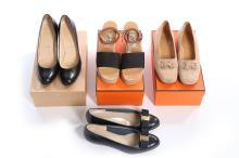 Designer footwear, modern, comprising Louboutin black leather stilettos; He