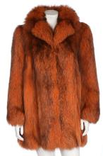 A Dior orange fox fur coat, probably 1980s, boutique labelled, with suede i