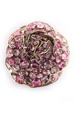 An Iradj Moini rose brooch with pink oval-cut glass stones in a brass setti