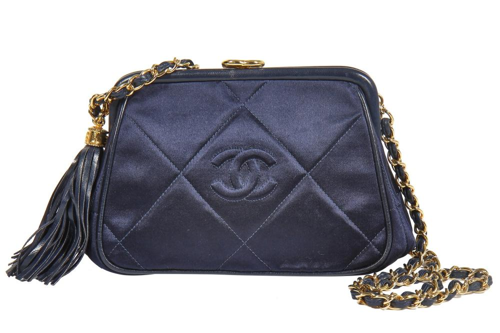 A Chanel quilted midnight-blue satin evening bag, 1980s