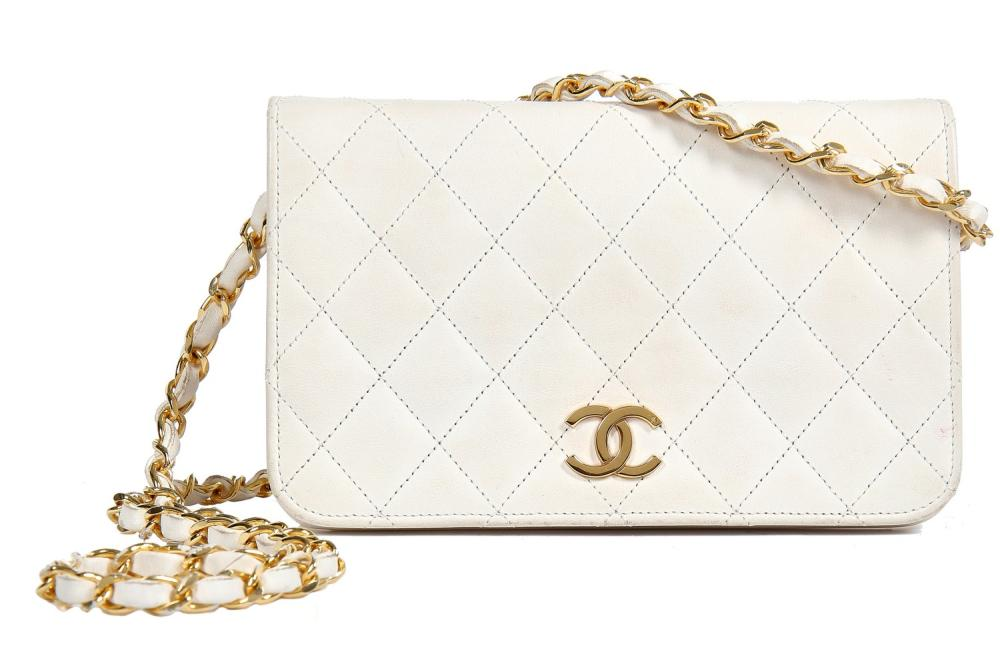 Three Chanel quilted lambskin leather handbags in shades of white, 1980s,