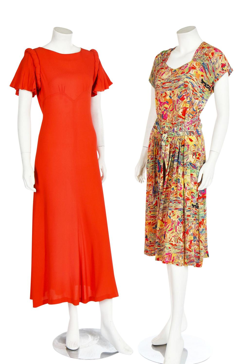 Eight dresses, mainly in shades of burnt-orange and black, 1940s,