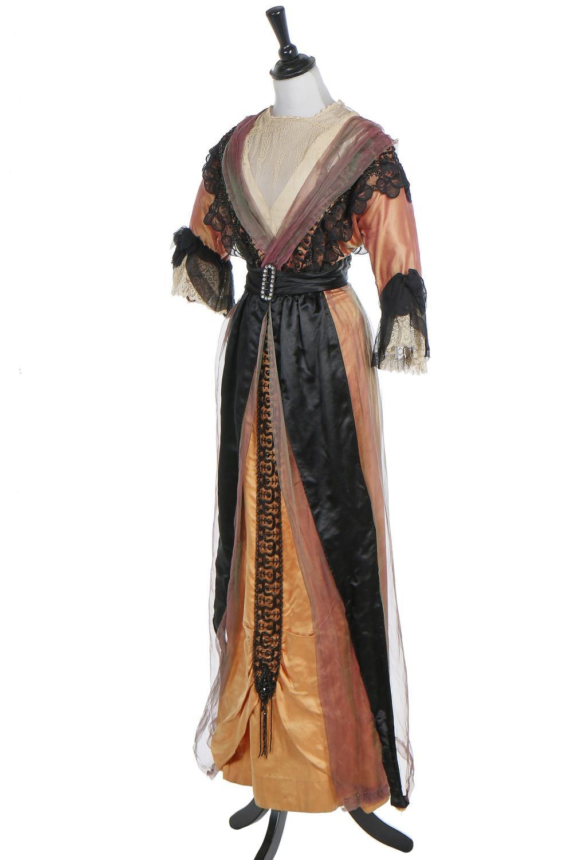 An orange satin evening gown, 1912-1913,