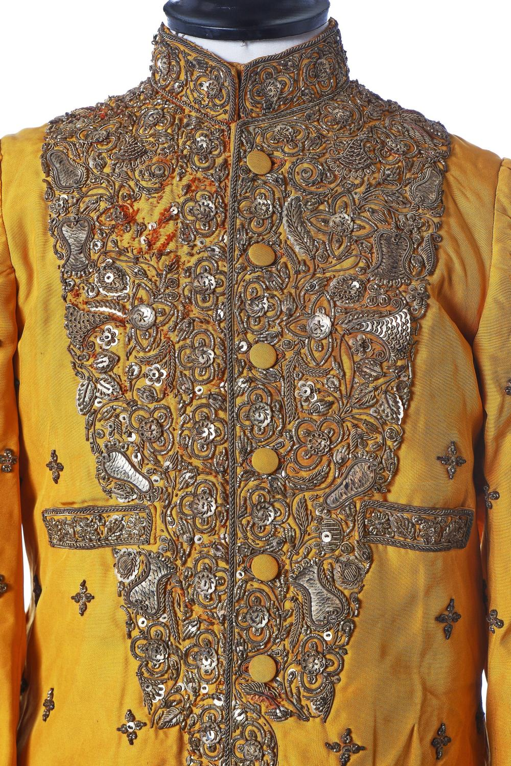 A young man's brilliant yellow silk court coat, Indian, 1910-20