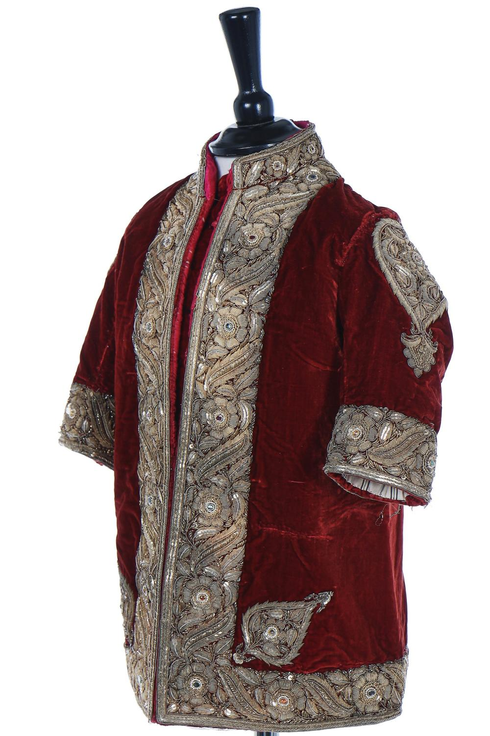 A boy's embroidered scarlet velvet court coat, Indian, late 19th century,