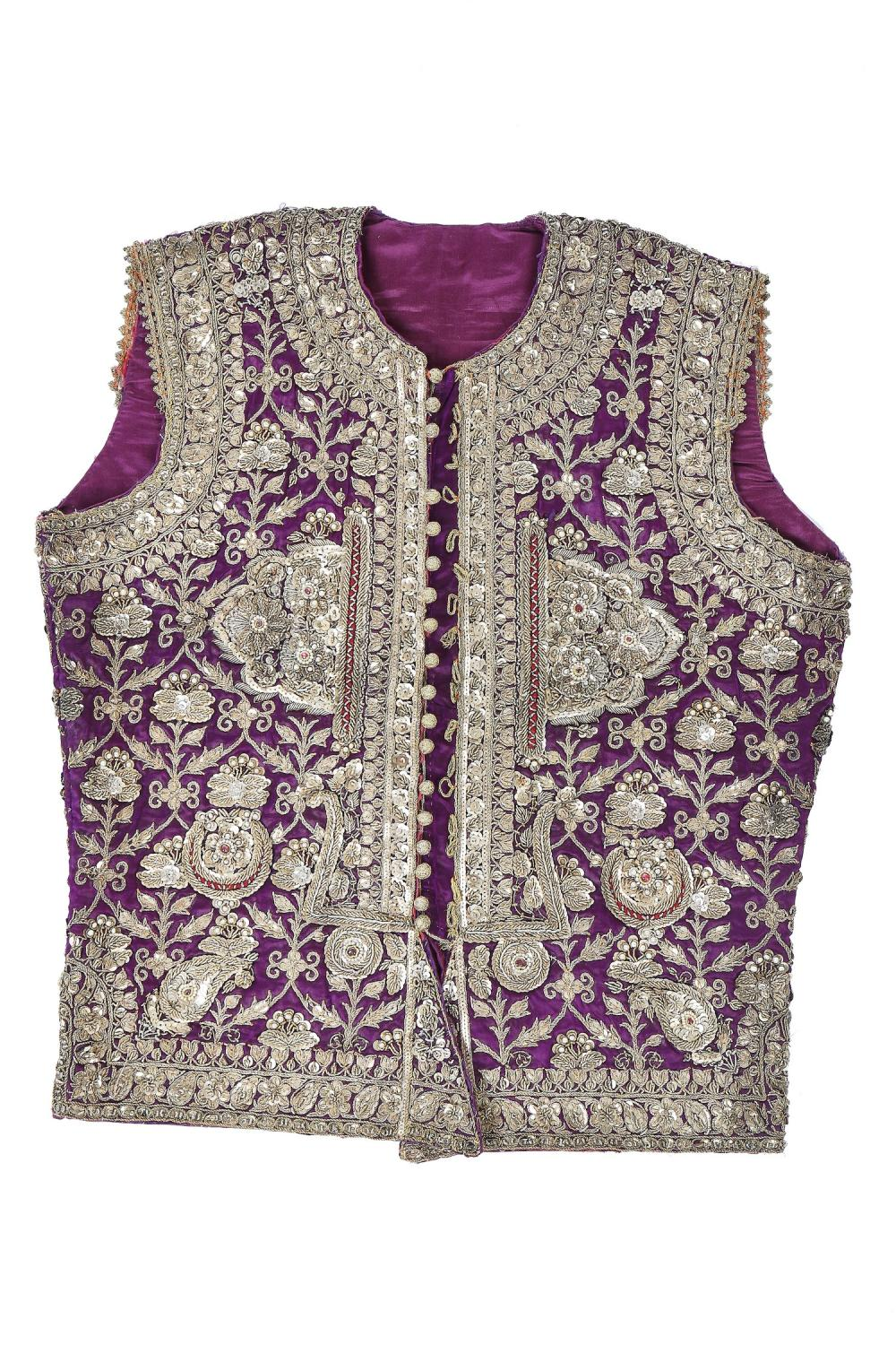 A boy's elaborately embroidered and bejewelled purple satin waistcoat, Indian, late 19th century