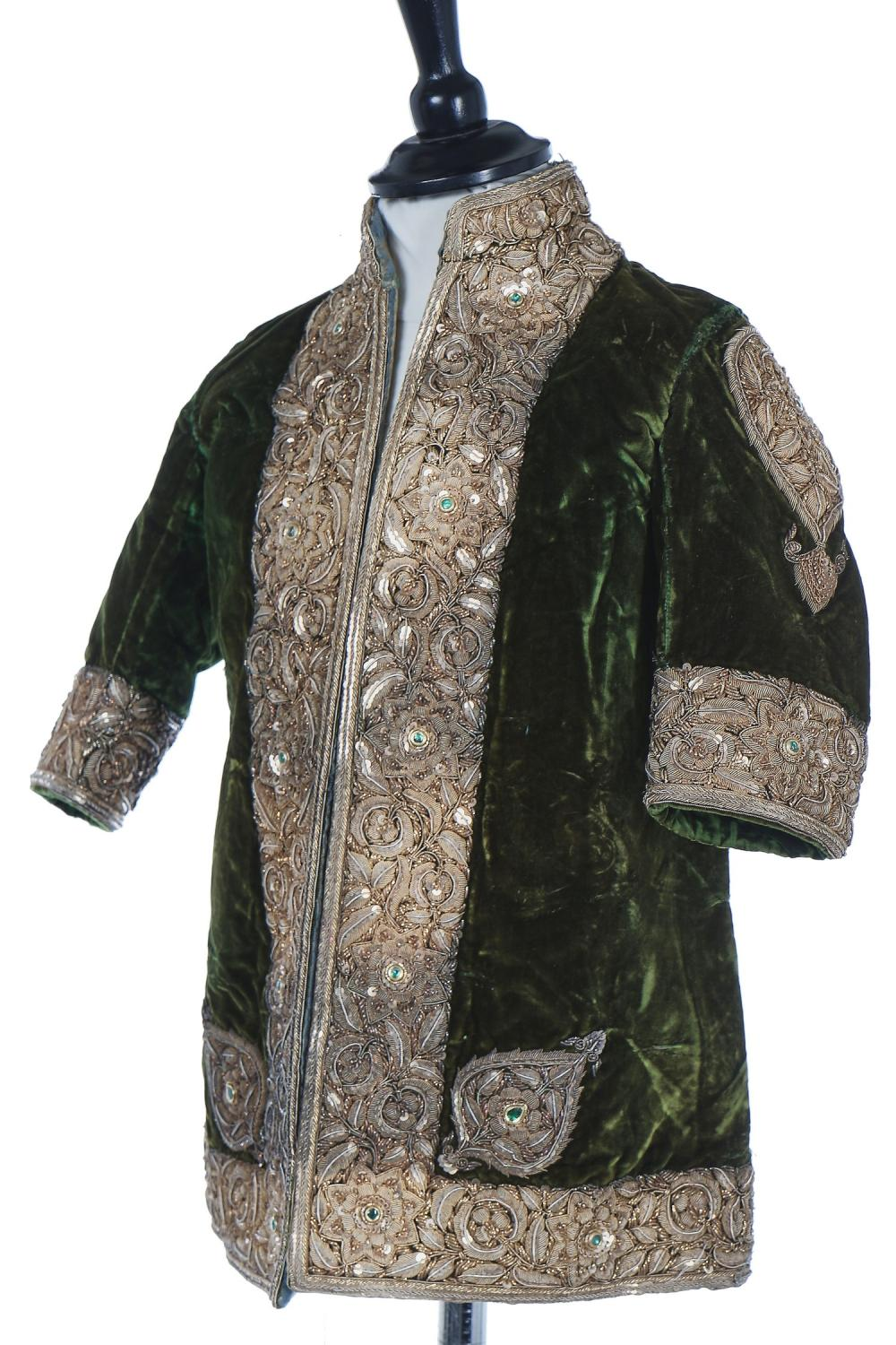 A boy's embroidered olive-green velvet court coat, Indian, late 19th century,