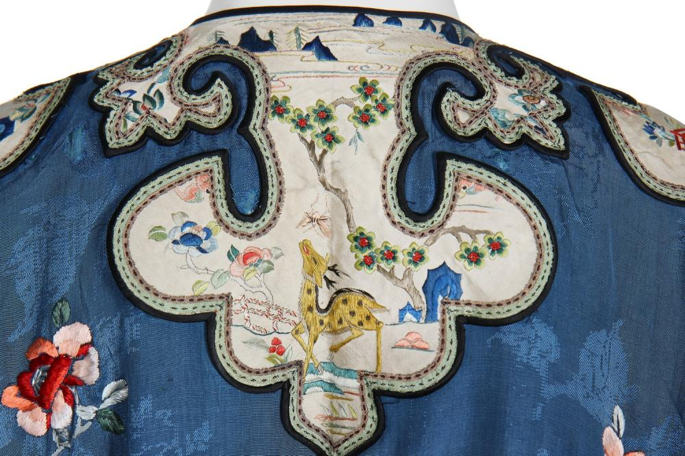 An informal robe of embroidered blue silk-damask, Chang-Fu, Chinese, 1920s-30s,