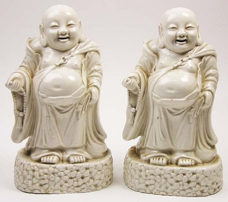 A pair of Chinese glazed white figures of Buddha,