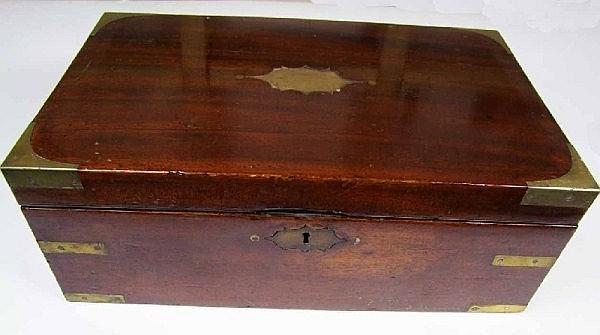 A Victorian mahogany and brass cornered writing