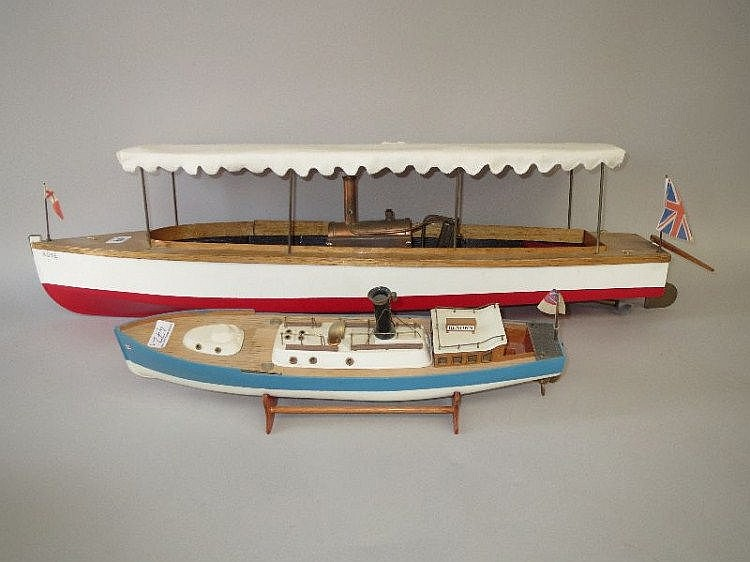 Two wooden models of boats, one 'Rose' complete