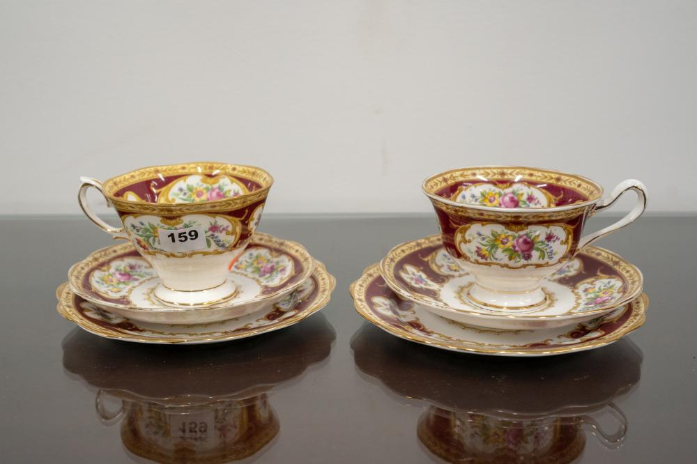 A pair of Royal Albert bone china Trio sets including cups, saucers and plates
