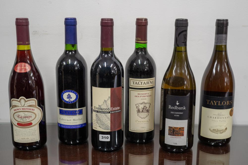 6 assorted red wine bottles