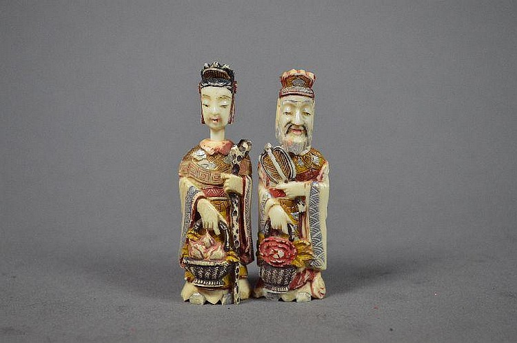 A pair of carved multicolored ivory snuff bottle