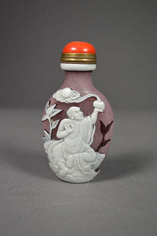Carved Peking glass snuff bottle