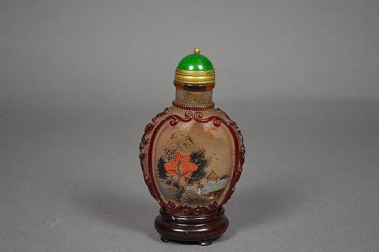 Reverse painting on carved Peking glass snuff bottle.
