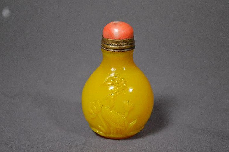 Carved imperial yellow Peking glass snuff bottle