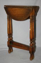 Small oak folding dropside table. 24
