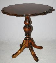 Scalloped edge pedestal urn form table in walnut. 30