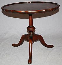Small mahogany pie crust table on tri-pod pedestal base