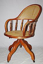 American walnut & cane swivel desk chair