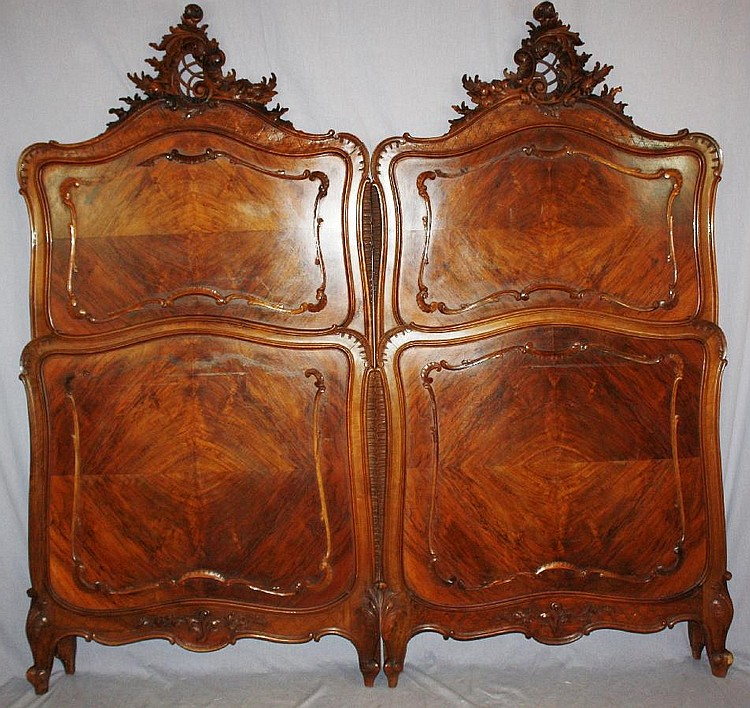 Pair of French Louis XV carved walnut beds