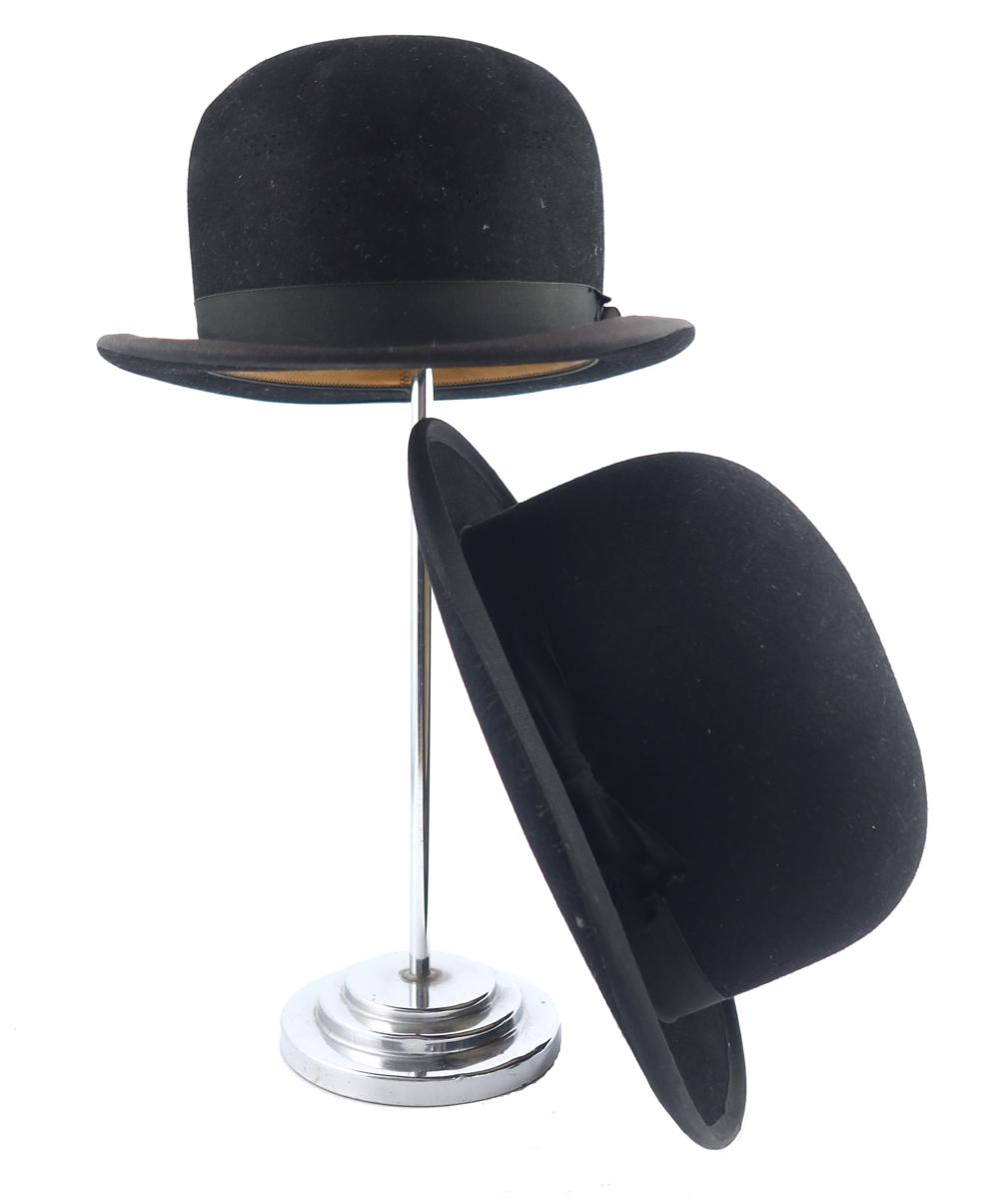 Two bowler hats, one a substantial weigh