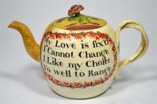 A Wedgwood creamware bullet shaped tea pot with rose flower finial, decorat
