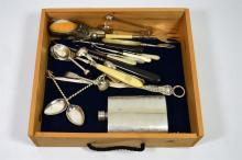 A selection of silver plated spoons, crochet hooks, a pair of sugar tongs a