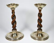 A pair of silver candlesticks with oak handed spiral stems by Albert Edward