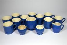 A Moorcroft powder blue part tea set, includes ten coffee cups, two milk ju