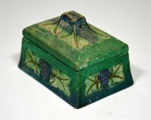 A Compton Pottery box and cover, decorated with grapes and vine leaves. Cir
