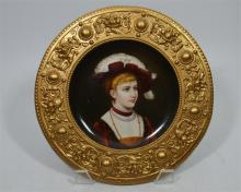 A Berlin plaque with metal surround, decorated with a hand painted figure o