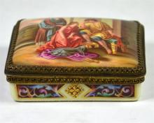 A Vienna style porcelain box and cover. The cover painted with a Mythologic