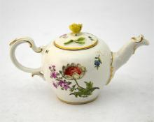A Vienna porcelain teapot and cover, having an elaborate scroll handle and