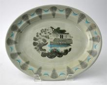 A Wedgwood platter 'Travel' designed by Eric Ravilious, decorated with a ri