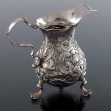 A George II silver jug, Dorothy Mills an
