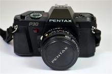 A Pentax P30 camera in a leather case.