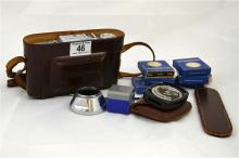 A Voigtlander Bessa I camera and case, with several filters.