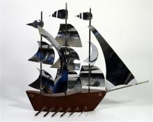 A Chrome and wooden yacht, Height 40cm.