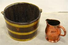A brass banded wooden bucket with a copper jug. Height of barrel 24cm.