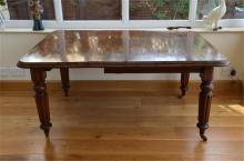 A Victorian mahogany extending dining table, with extra leaf and winding ha