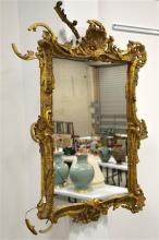 A gilt and plaster wooden framed over mantle wall mirror, floral rococo des