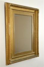 A George III gilt carved mirror, circa 1800. 68cm x 52cm.